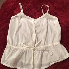 Peplum button up and tie tank This is a super cute tank. Maybe been worn once. Super cute in the summer with jean shorts! Ask me anything! Forever 21 Tops Tank Tops