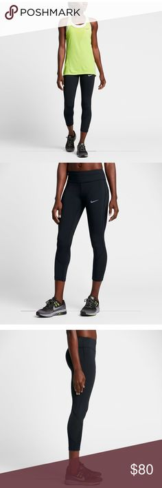 """NWT Nike Epic Lux Tight Fit Crop The Nike Epic Lux Women's 22"""" Running Crops, featuring smooth, supportive Nike Power fabric, are great for working out or for everyday wear. Black. Style: 842921-010. Mesh fabric wraps from behind your knees to your shins to keep air flowing. Dri-FIT Technology wicks sweat away from your skin to help keep you dry. Drawcord in waistband lets you adjust the fit. Nike Pants Leggings"""