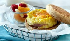 Microwave Egg, Canadian Bacon & Cheese Muffin recipe: This quick and easy microwave scrambled egg and Canadian bacon muffin is an excellent source of protein. Top with fresh tomato and avocado slices. Easy Egg Recipes, Muffin Recipes, Gourmet Recipes, Cooking Recipes, Bacon Recipes, Cheese Recipes, Kitchen Recipes, Delicious Recipes, Cooking Tips