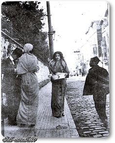Istanbul 1910s.  A lady raises money for the 'Red Crescent' (the Turkish counterpart of the Red Cross).