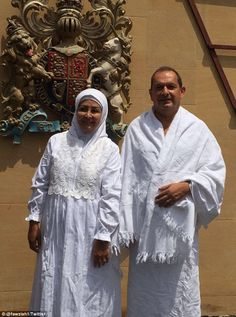 Simon Collis pictured with Syrian wife Huda al-Mujarkech after making the pilgrimage to Mecca. He decided to convert to Islam 'after spending 30 years in Muslim societies'