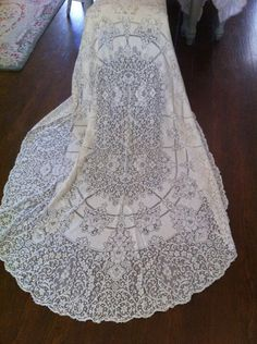 Beautiful Oval Floral Scallop Edge Quaker Lace Table Cloth - Cottage Chic - Table Runner - Off White - Shabby Chic. $42.00, via Etsy.