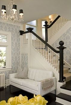 Black handrails, white pickets, black painted floors and stairs, white risers.