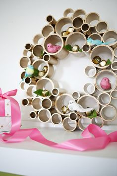 Holiday wreath made from PVC pipe - This would be great storage solution for a craft room! (ab)