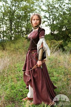 This listing includes the following items with 15% discount: 1. Linen dress with short sleeves (burgundy on photo). Slim fit bodice of the tunic emphasizes breast and waist while wide skirt with 4 additional gussets drapes with soft pleats. All this combines into well-known medieval silhouette of the XIII-XIV centuries. Available in different colors. The skirt is hemmed with the trim as well as sleeves and neckline. Also the trim is used to decorate the lacing fastening at the fore part of a…