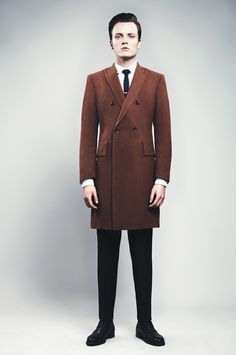 I love the high, neat button stance on this Ozwald Boateng coat.