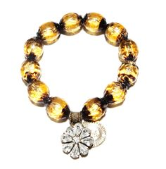 Maritime Sunset Love Cures Bracelet --    Nautical Sunsets with the Maritime Love Cures Stretch Bracelet in Antique Belgium Gold glass beads adorned with a Swarovski Crystal Floral. -- $65.00