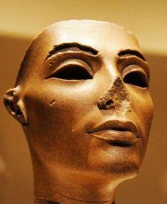 Face from a Composite Statue of Nefertiti. 18th Dynasty, reign of Akhenaten (1353-1336 BC). Brown quartzite. Egyptian Museum, Cairo.