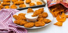 Doritos Crusted Chicken Fingers only 5 steps 1. Marinate chicken strips in buttermilk for 2 hours.  2 Dredge in flour.  3 Dip in egg wash 4. Dredge in crushed Doritos (flavor of choice) 5. Bake in a 400F for 15-20 minutes.  Serve with Ranch dressing