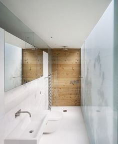 small bathroom idea - for a more square shape, you could put the sink across from the toilet de glazen wand met verlichting erachter maakt heel ruimtelijk en fris Ensuite Bathrooms, Laundry In Bathroom, Bathroom Renos, Bathroom Layout, Bathroom Faucets, Bathroom Interior, Design Bathroom, Minimalist Interior, Minimalist Bedroom