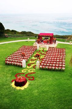 Do you want to have a destination wedding, but not away from home? Here are 10 reasons to plan a great desi Indian beach wedding instead. Red Wedding Decorations, Desi Wedding Decor, Flower Decorations, Reception Decorations, Wedding Centerpieces, Wedding Aisles, Wedding Mandap, Table Wedding, Wedding Stage