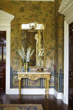Dark, hand painted walls, mouldings, gilt