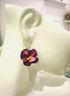 crochet earrings that look like pansies or violets