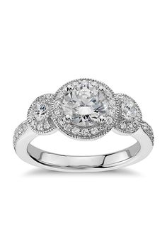 Brides.com: . Style 42401, three-stone milgrain halo diamond engagement ring in 14k white gold, $1,520 (center stone not included ), Blue Nile