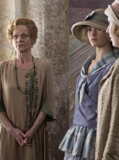 DOWNTON ABBEY •Samantha Bond/Lady Rosamund Painswick  •Laura Carmichael performs her role as Lady Edith Crawley  •Lily James is Lady Rose MacClare, Cousin of the Crawleys by way of The Dowager Countess's niece, Susan, and her husband Hugh
