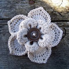 I'm really into #crochet flowers right now because they are just so beautiful. I love how this one has a button center to give it a little bit of depth.