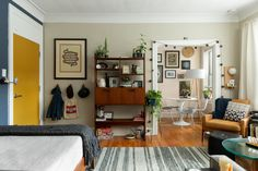 Each one of these homes is 400 square feet or under, but they're all well organized and good looking. Find smart storage solutions, double-duty furniture, and other clever ways to make the most of a small home. Home Design, Interior Design, Studio Apartment Decorating, Apartment Therapy, Studio Apartment Living, Studio Living, Black Floating Shelves, Yellow Throw Pillows, Leather Recliner Chair