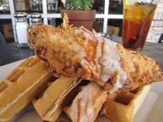 Enjoy Chicken and Waffles with Gravy and Hot Sauce every Thursday at Bread Winners Cafe and Bakery in Dallas, TX
