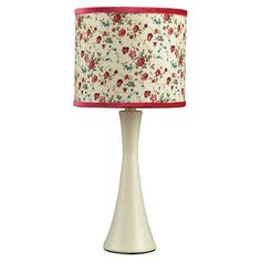 Antiqued white table lamp with a floral drum shade.    Product: Table lampConstruction Material: Composite and fa...