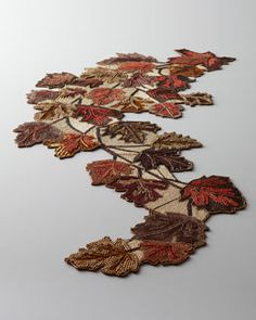 """Kim Seybert """"Blowing Leaves"""" Table Runner – nice for fall table scape – Food: Veggie tables Table Runner And Placemats, Quilted Table Runners, Skinny Quilts, Boho Home, Fall Quilts, Tablerunners, Penny Rugs, Felt Applique, Leaf Table"""