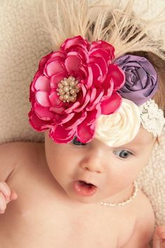 Be sure to add this Boutique Marabou Headband in Hot Pink and Purple to your little girls wardrobe. Perfect for pictures!