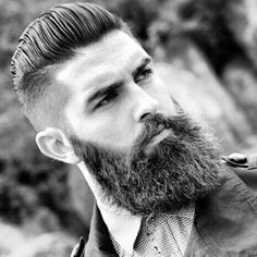 High Fade with Slicked Back Hair and Thick Beard
