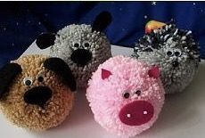 DIY Pom Pom animals - easy craft for make and take bags in the maker space. Make a dog, pig, cat