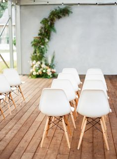 White Eames Chairs Ceremony Seating and Apricot and Blush Colored Floral Backdrop White Eames Chair, Eames Chairs, Wedding Ceremony Seating, Wedding Receptions, Dark Color Palette, Floral Backdrop, Traditional Furniture, Wedding Shoot, Chair Design
