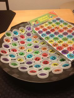 Bottle Cap Letters Using Stickers! & then the bottles are labeled with the other case letter