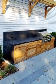 This gorgeous outdoor installation is a double waterfall outdoor grillmaster's dream. The piece features a custom fit Sphynx concrete countertop, backsplash, and waterfall edges. Also, is there anything more appealing as concrete and wood together? I didn't think so either. #custom #concrete #countertop #waterfall #grilling #summer #wood #patio #outdoor #kitchen #RockMill Outdoor Countertop, Countertop Backsplash, Custom Countertops, Concrete Countertops, Concrete Sink, Concrete Patio, Wood Patio, Outdoor Pergola, Sphynx