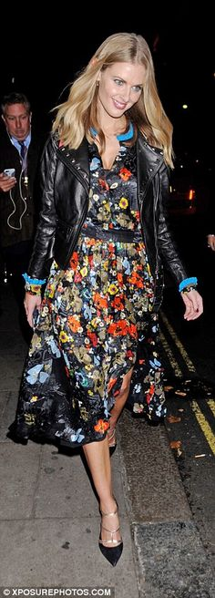 Not leaving empty handed: Donna exited the party, held at Charlie in Mayfair, with armfuls...