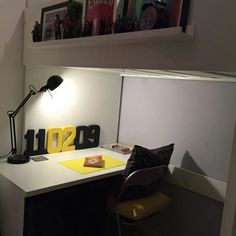 Ikea stuva loft bed, making the most out of a tiny room. Photo ledge added to bed to display figures, pictures, toys and clock. White fresh room with grey feature wall. Black and yellow accessories. Date of birth feature display art #hobby #craft