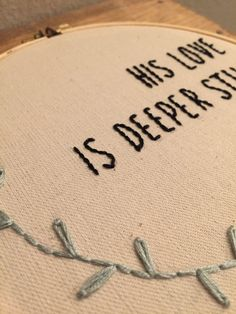 this is a custom made embroidered hoop with a personal design created by randi. the phrase is His love is deeper still.      a b o u t t h e p r o d u c t     - 8 wooden hoop - hand-stitched - canvas fabric - black & blue thread      p e r f e c t f o r     - home decor - gift      c u s t o m i z e     - custom orders always available!      s h o w s o m e l o v e     - click on the <3 icon and save as a favorite! - add to cart to purchase your own!      c o n n e c t     - instagram:...
