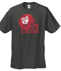 """Be a champion for helping save lives with the """"Buckeye Blood Donor"""" football t-shirt! Free when you register to donate Today, Nov. 17 through Dec. 13 at any CBC Donor Center & most CBC mobile blood drives!"""