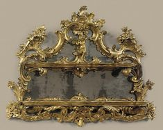 A NAPOLEON III CARVED GILTWOOD ETAGERE MIRROR