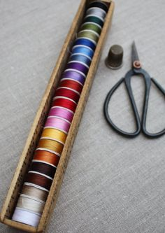 Handmade bobbin box made from yardsticks. Great for sewing room storage, thread storage, or gift for quilter, sewist, or crafter. Made by Temecula Quilt Co in California.