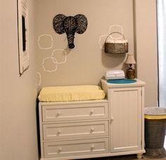 yellow and grey nursery with elephant motif