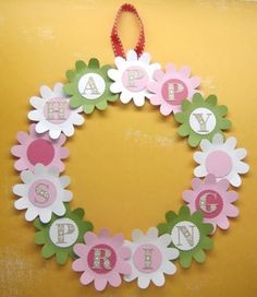This pretty, handcrafted flower wreath is made from cardboard and cardstock. Cut out the circle with circle cutter or scissors from cardboard. Inside and out.