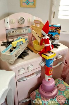Elf making brownies- More Unique Elf on the Shelf Ideas