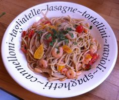 Spaghetti with fried prawns, peppers, tomatoes, onions, garlic and green chillies. Topped with fresh parsley.