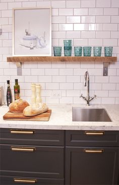 Love the grey cabinets and brass pulls. via: Little Green Notebook