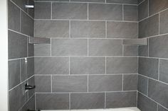 Almost Finished Tiling In Tub Surround Large Grey Tiles Grouted With Pearl Gray Sanded Grout