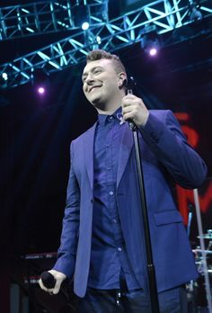 He wants the audience to stay with him. Sam Smith smiles through his performance on April 15 in Los Angeles
