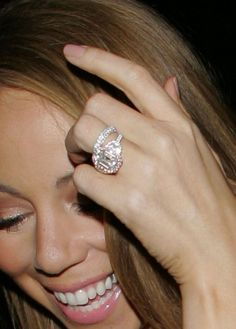 Mariah Carey's $ 2.5 million engagement ring from Nick Cannon. Cannon worked with Jacob & Co to design this 17-carat stunner. Its a square emerald-cut pink center diamond surrounded by 58 intense pink diamonds and two half-moon diamonds on each side.