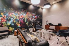 How WeWork Experiments On Itself to Advance the Field of Office Design,Every WeWork location has some local element; the headquarters has a mural featuring a timeline of New York musicians—from rock and roll to hip-hop—along a narrow corridor. Image © Lauren Kallen