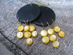 Polymer clay discs carry the Mother of Pearl beads in yellow,