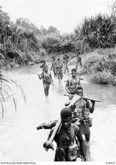 Troops of the New Guinea Infantry Battalion wade a small stream on their way to attack the village of Gisananbu, a Japanese position. Three Australians accompanying them at rear. Northwestern coast of New Guinea. Non Commissioned Officer, Fuzzy Wuzzy, Lest We Forget, Jehovah's Witnesses, Papua New Guinea, World War Two, Troops, Wwii, Coast