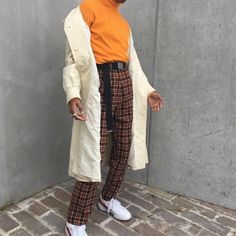 Super retro look, with white trench and plaid pants (obsessed)