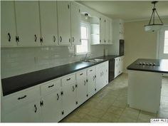 kitchen cabinets-- love the hinges
