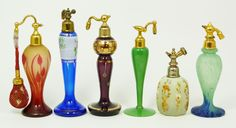 6 BOHEMIAN & FRENCH ART GLASS ATOMIZER BOTTLES  6 Bohemian & French art glass atomizer bottles. Lot includes a Marcel Franck atomizer with Czech bottle. A DeVilbiss bottle. A D'Argental (St. Louis) cameo glass bottle. The rest are unmarked.